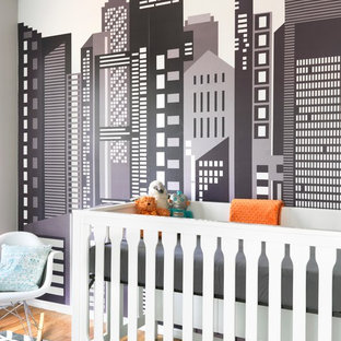 Inspiration for a 1950s gender-neutral light wood floor nursery remodel in St Louis with multicolored walls