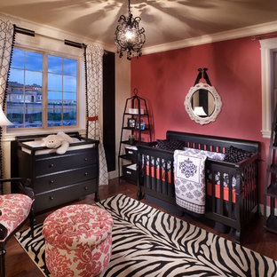 Medium sized mediterranean nursery for girls in Denver with pink walls and dark hardwood flooring.