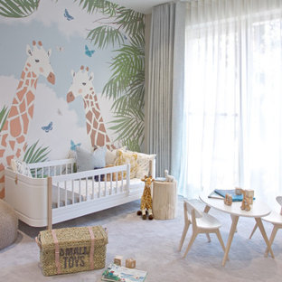 Large contemporary nursery for girls in London with grey walls, carpet and grey floors.