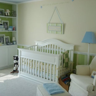 Photo of a traditional gender neutral nursery in Indianapolis with carpet.