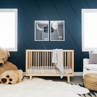 Mid-sized transitional boy carpeted and gray floor nursery photo in Orange County with blue walls