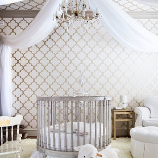 Inspiration for a mediterranean nursery for girls in Austin with multi-coloured walls and beige floors.