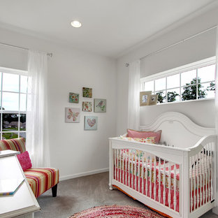 Inspiration for a medium sized classic nursery for girls in Philadelphia with white walls, carpet and grey floors.