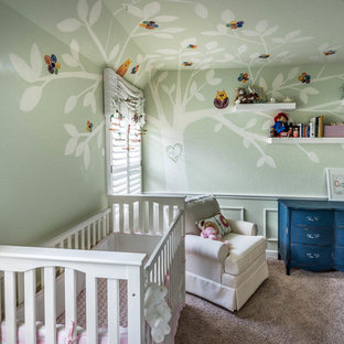 Design ideas for a large traditional nursery for girls in Houston with green walls and carpet.