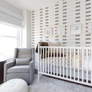 Nursery - transitional gender-neutral dark wood floor nursery idea in DC Metro with white walls