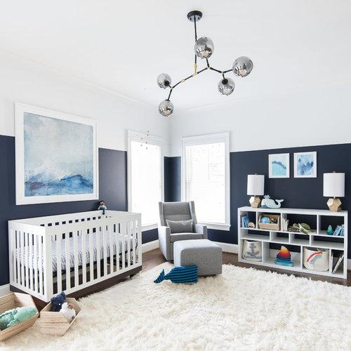 Example of a transitional gender-neutral dark wood floor and white floor nursery  design in