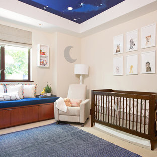 Medium sized traditional gender neutral nursery in Los Angeles with beige walls, carpet and beige floors.
