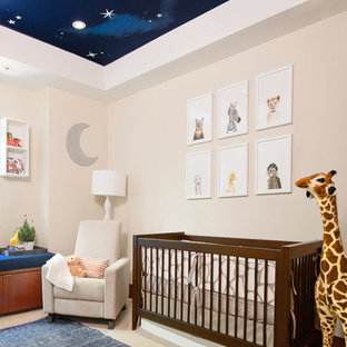 Medium sized classic gender neutral nursery in Los Angeles with beige walls.