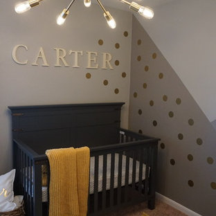 This is an example of a small modern nursery for boys in Houston with grey walls, carpet and beige floors.
