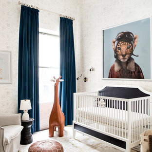Transitional gender-neutral nursery photo in New York with white walls