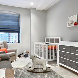 Inspiration for a small contemporary gender neutral nursery in New York with grey walls, light hardwood flooring and grey floors.