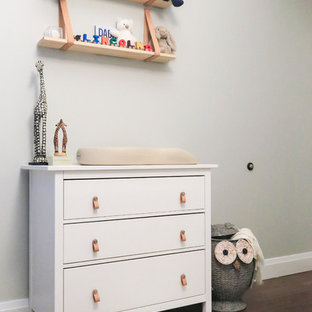 Example of a small minimalist gender-neutral nursery design in New York