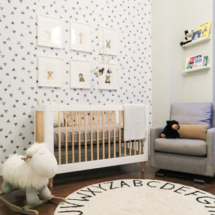 Nursery - small contemporary gender-neutral dark wood floor and brown floor nursery idea in New York with gray walls