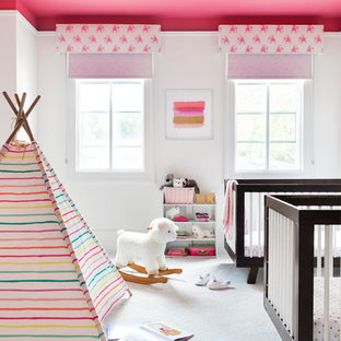 Medium sized scandi nursery for girls in New York with white walls, carpet and white floors.