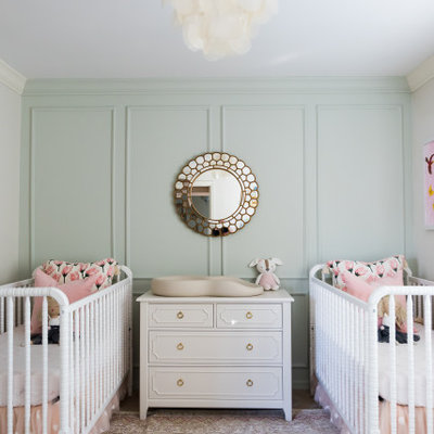 Example of a mid-sized transitional girl medium tone wood floor and beige floor nursery design in Orlando with green walls