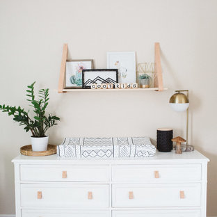 Inspiration for a mid-sized eclectic gender-neutral medium tone wood floor nursery remodel in Orange County with beige walls
