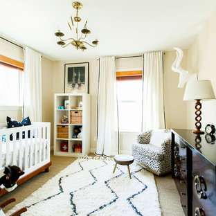 Inspiration for a medium sized eclectic gender neutral nursery in Austin with beige walls and carpet.