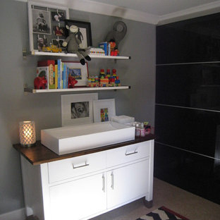 Inspiration for an eclectic nursery for boys in Sacramento with grey walls.