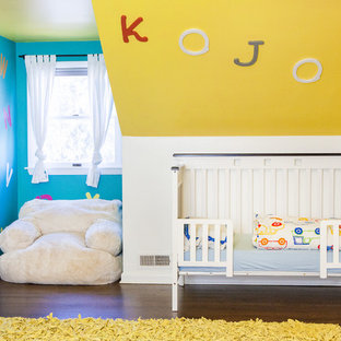 Inspiration for an eclectic gender neutral nursery in Columbus with yellow walls, dark hardwood flooring and brown floors.