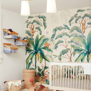 Inspiration for a contemporary gender-neutral medium tone wood floor and brown floor nursery remodel in Los Angeles with white walls