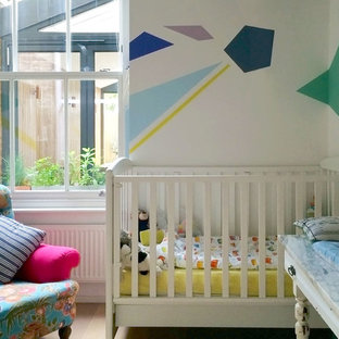 Design ideas for a small contemporary gender neutral nursery in London with multi-coloured walls.