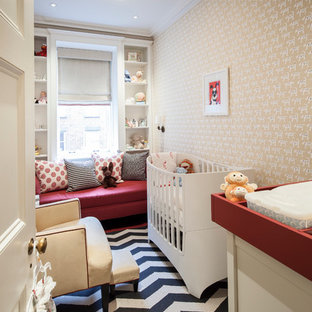 Example of a transitional gender-neutral carpeted and multicolored floor nursery design in New York with multicolored walls