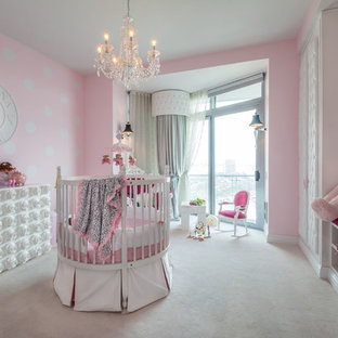 Inspiration for a large traditional nursery for girls in New York with pink walls, carpet and white floors.