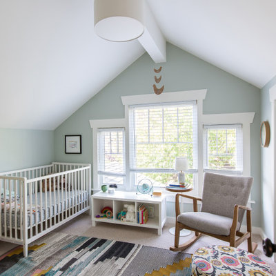 Inspiration for a mid-sized transitional gender-neutral carpeted and beige floor nursery remodel in Seattle with green walls