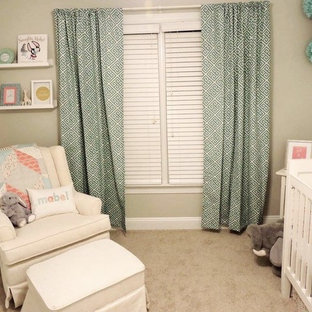 Example of a small classic girl carpeted nursery design in Raleigh with gray walls