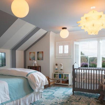 Mid-sized elegant boy dark wood floor nursery photo in New York with white walls