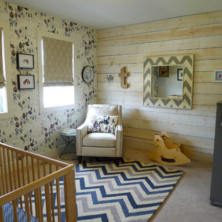 Inspiration for a medium sized bohemian gender neutral nursery in Boise with multi-coloured walls and carpet.