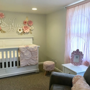 Medium sized traditional nursery for girls in Chicago with beige walls, carpet and beige floors.