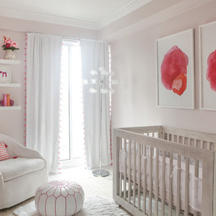 Inspiration for a classic nursery in New York with pink walls.