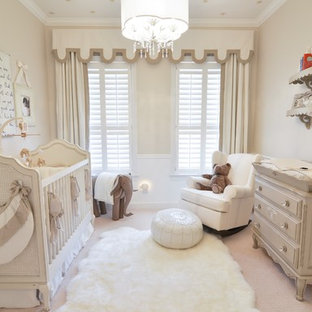 Example of a mid-sized transitional gender-neutral carpeted nursery design in Orlando with beige walls