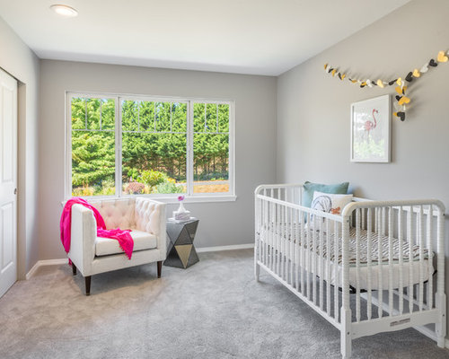 inspiration for a transitional girl carpeted and gray floor nursery remodel in seattle with gray walls - Nursery Design Ideas