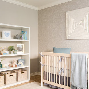 Nursery - large modern boy light wood floor nursery idea in Los Angeles with gray walls