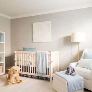 Photo of a large classic gender neutral nursery in Los Angeles with grey walls, light hardwood flooring and beige floors.