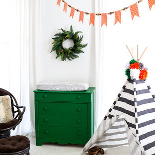 Design ideas for a medium sized bohemian gender neutral nursery in Atlanta with white walls and painted wood flooring.