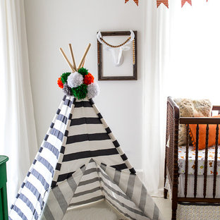 Medium sized eclectic gender neutral nursery in Atlanta with white walls and painted wood flooring.