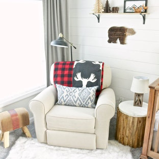 This is an example of a medium sized rustic nursery for boys in Bridgeport with white walls, carpet and grey floors.