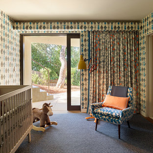 Photo of a bohemian nursery for boys in San Francisco with multi-coloured walls and carpet.