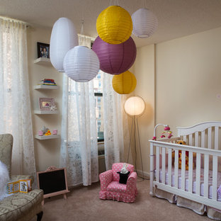 Example of a transitional girl carpeted nursery design in New York with beige walls