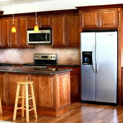 """Cafe Mocha Glaze 18 Waste Basket Base Cabinet - The Cafe Mocha Glaze kitchen cabinet collection offers a lovely warm coffee color that will enhance the beauty of your home. Not only are the raised panel, solid maple door fronts traditional and elegant but they are great quality, too! The cabinets come with full extension, dovetail drawers and soft close drawer glide features. Width 18"""" Height 34.5"""" Depth 24"""".  1 door waste basket base cabinet that  has 1 drawer and 1 pre-cut hole for trash bins. Does not include trash bins. Fits a trash bin that measures 8""""W x14""""H with a height of 15""""."""