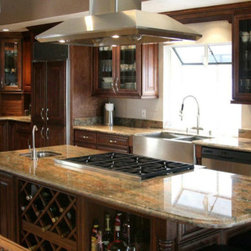 "Java Maple Glaze 33x84 Single Oven Cabinet - The Java Maple Glaze kitchen cabinet collection offers a warm and rich chocolate finish. These cabinets are elegant and timeless and will enhance any kitchen design. The Java Maple cabinets are well-crafted and will withstand the test of time. If you're looking for a sophisticated and elegant new kitchen than these are the cabinets for you! Width 33"" Height 84"" Depth 27"".  2 door single oven cabinet that has 2 doors on top and 2 drawers on the bottom. The oven opening is 30""W x 38""H and can be cut up to 48""H. The width of 30"" can be cut up to 31.5""W if necessary. The single oven cabinet is designed with a big enough opening to accommodate both an oven & microwave."