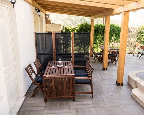 Foto e idee per patii e portici patio o portico moderno for Come costruire un mazzo di portico anteriore