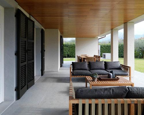 Foto e idee per patii e portici patio o portico moderno for Foto di portici per case