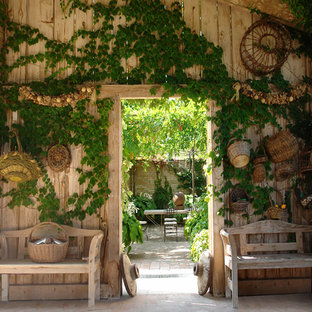 Example Of A Mid Sized Country Courtyard Patio Vegetable Garden Design In Other