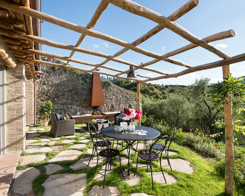 Example Of A Country Front Yard Stone Patio Kitchen Design In Florence With  A Pergola