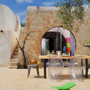 Esempio di un patio o portico stile americano di medie dimensioni e dietro casa con nessuna copertura