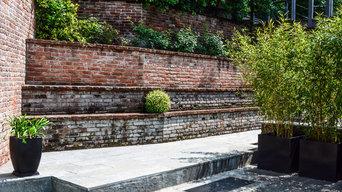 Restauro minimal di un giardino in collina di Torino